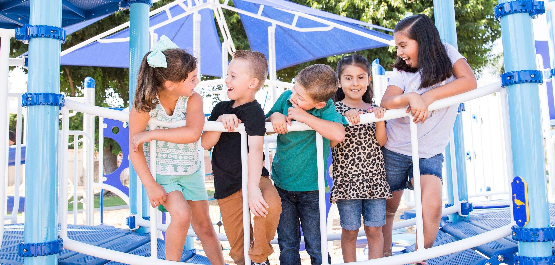 children on playground bridge